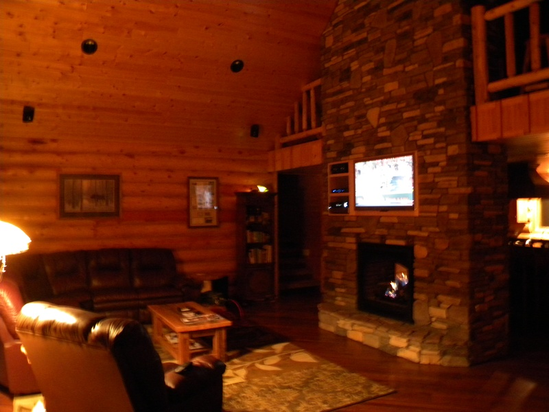 "Great room with fireplace & 50""HDTV"